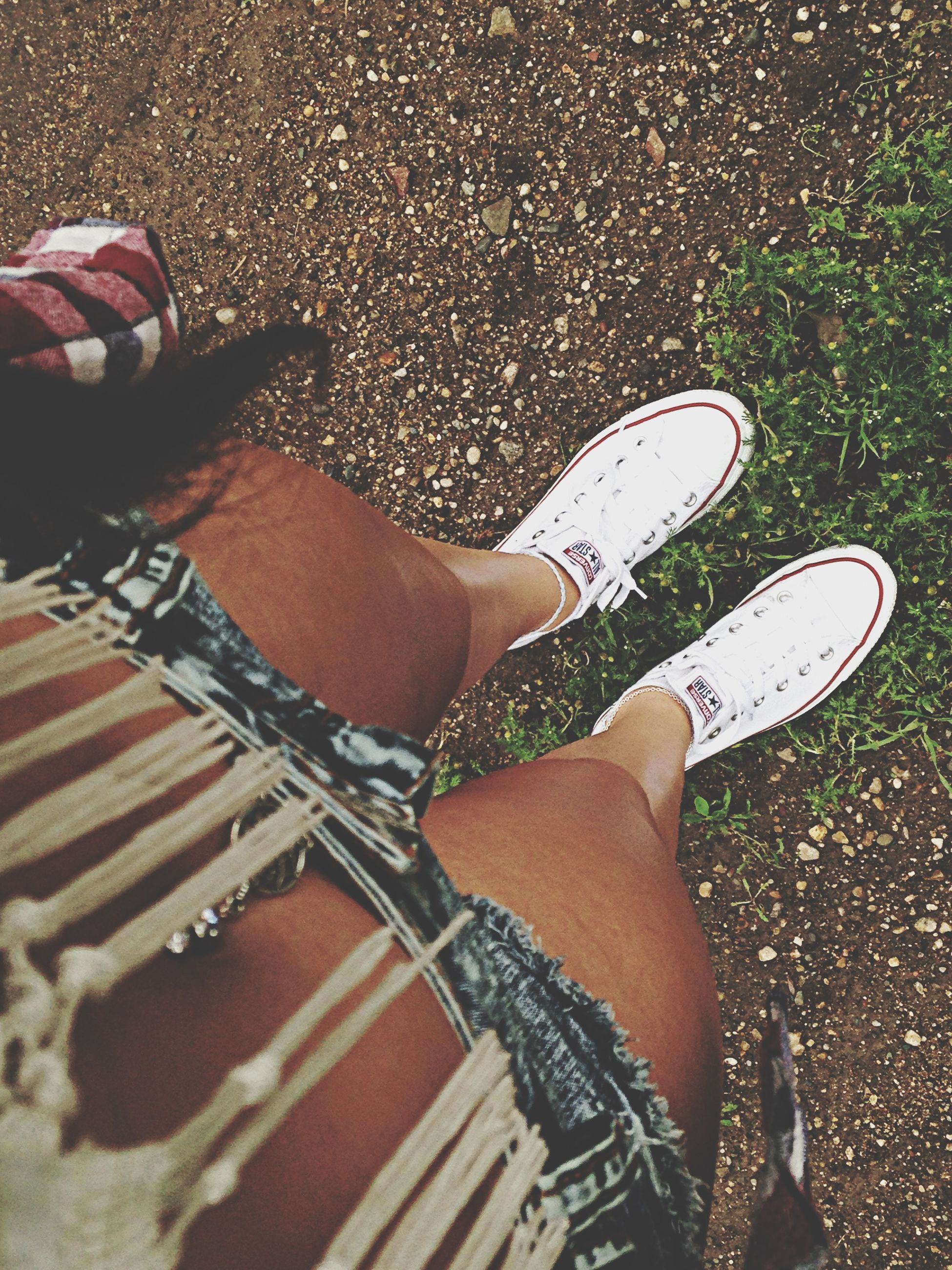 low section, person, shoe, personal perspective, lifestyles, high angle view, footwear, leisure activity, human foot, standing, street, men, fashion, part of, canvas shoe, pair