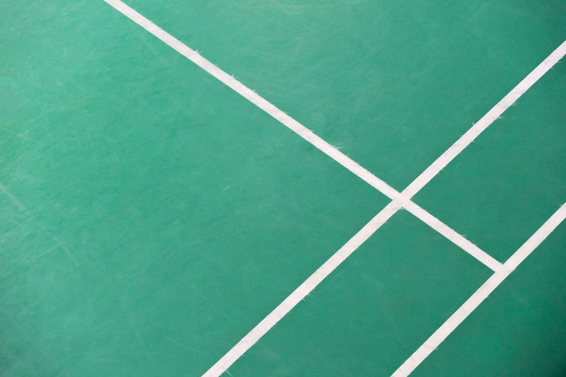Corner of badminton court Absence Backgrounds Competition Competitive Sport Court Day Dividing Line Full Frame Green Color High Angle View LINE Net - Sports Equipment No People Outdoors Pattern Playing Field Single Line Sport Tennis White Color Yard Line - Sport