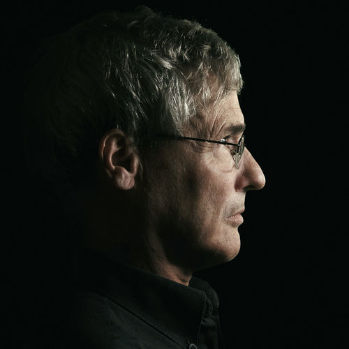 Side View Of Man Wearing Eyeglasses Against Black Background