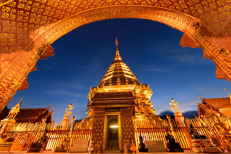 golden temple in twilight time in northern of Thailand King - Royal Person Gold Statue Place Of Worship Adulation Gold Colored Arrival Ancient Business Finance And Industry Religion Praying Ancient Civilization Pagoda Monument Stupa Civilization Prayer Flag