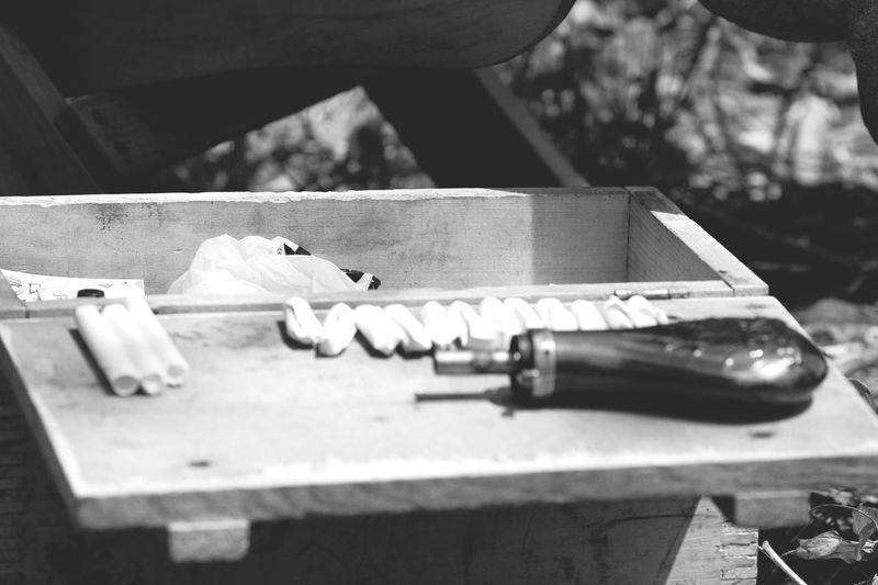 Black Powder Cartridge Box, Battle of Westport re-enactment Storage Box Black Poder Cartridges Selective Focus Close-up Equipment Day Table Sunlight Wood - Material No People Preparation  Still Life Metal Work Tool Tool
