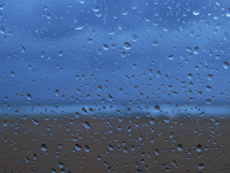 Rainy day by the seaside Abstract Backgrounds Beauty In Nature Blue Clouds Day Fromthecar Nature No People Outdoors Raindrops Rainy Day Sand Sea Sky