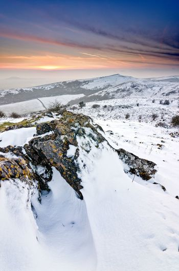 A snowy winter scene. crook peak from wavering down. mendip hills, somerset.