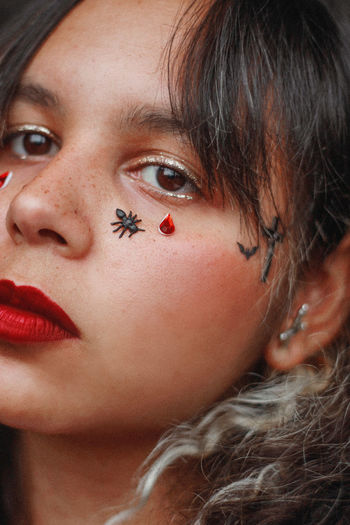 Close-up of woman with insect on face