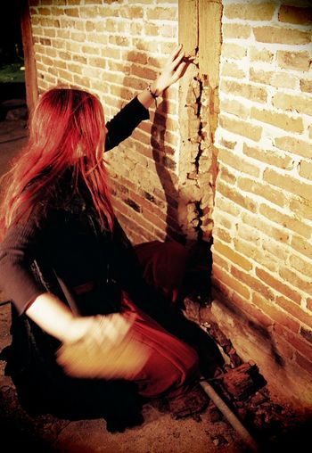 2004 College Project FilmPhotography Alone Debris Decay Escaping Gothic Morbid Abandoned Brick Brick Wall Built Structure Curiosity Decaying Destroyed Film Photography Goth Holding Human Hair Long Hair Obscured Face One Person Red Hair Structure Tearing Down Wall Wall - Building Feature