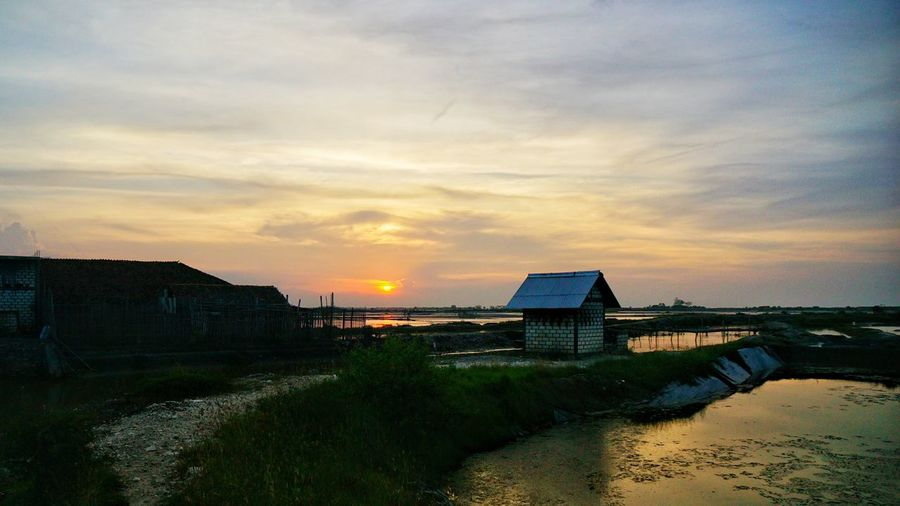 A cabin in Tambak Garam under twilight. Street Photography Photooftheday Street Capture INDONESIA Photography By @jgawibowo Shot By Arif Wibowo Photography Photo Twilight Twilightscapes Sunset From Around The World. Sunset Cloud - Sky Outdoors Tranquility Nature Sky Beach Architecture Landscape Water Beauty In Nature