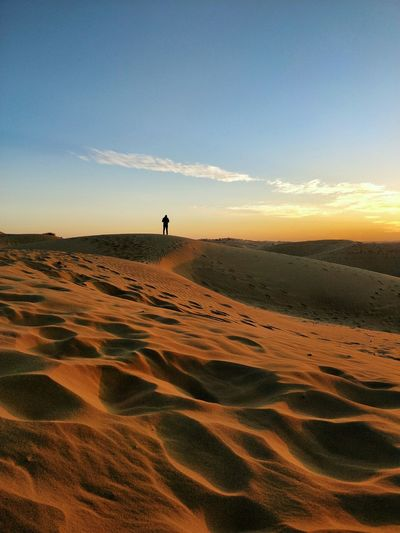 Sunset Sand Sky Sand Dune Landscape Desert Scenics Travel Destinations Outdoors Silhouette One Person Full Length Tranquility Minimalist Photography  Minimalpeople Human Body Part Minimalism_masters EyeEm Ready   An Eye For Travel California Dreamin The Mobile Photographer - 2019 EyeEm Awards The Great Outdoors - 2019 EyeEm Awards