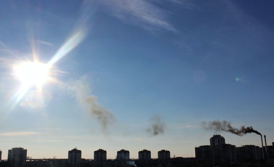 i know this picture doesn't have special artistic value, but i tried to capture something much more important. rise and shine, my dear sun :( Smoke Stack Factory Urban Skyline Day