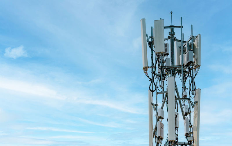 Telecommunication tower with blue sky background. antenna. radio and satellite pole.