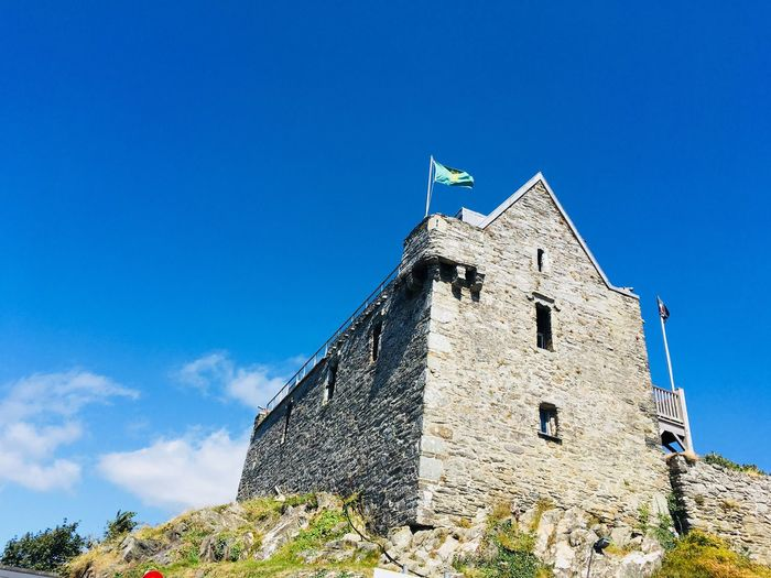 Where once pirates lived.. Beauty On My Doorstep Ireland West Cork Wild Atlantic Way Baltimore Ireland Castle Pirates Sky Architecture Built Structure Building Exterior Blue Building Nature Sky Architecture Built Structure Building Exterior Blue Building Nature History The Past Tower Flag