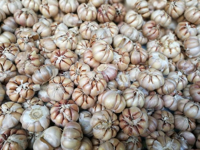 Full Frame Shot Of Garlic Bulbs For Sale In Market