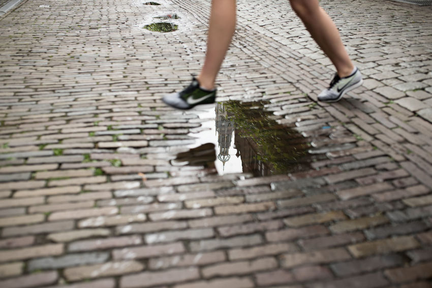 Crossing Grote Markt Haarlem Jump Legs Nike✔ Pass Puddle Puddleography Rain Rainy Days Reflection Road Street Tiles Water Woman Out Of The Box Sommergefühle