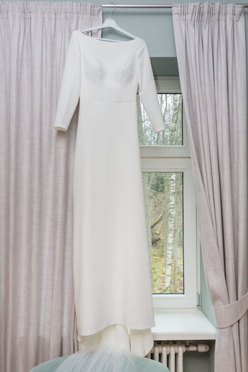 White clothes hanging on window