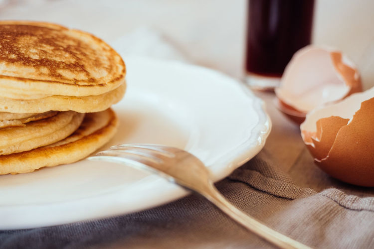 Close-Up Of Pancakes Served In Plate On Table