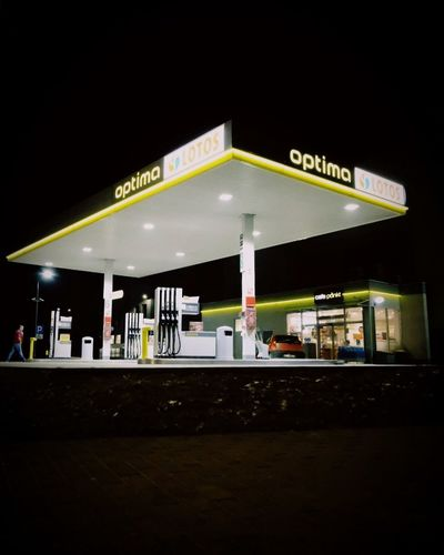 Night Gas Station Fuel Pump Illuminated Refueling Text Gasoline Neon Built Structure Architecture Outdoors