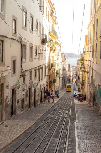 A typical day in Lisbon Portugal Perspective Europe Lisbon EyeEm Gallery EyeEm Best Shots Architecture Building Exterior Built Structure City Transportation Rail Transportation Railroad Track Mode Of Transportation Track Sky The Way Forward Street Building Residential District Day Direction Diminishing Perspective