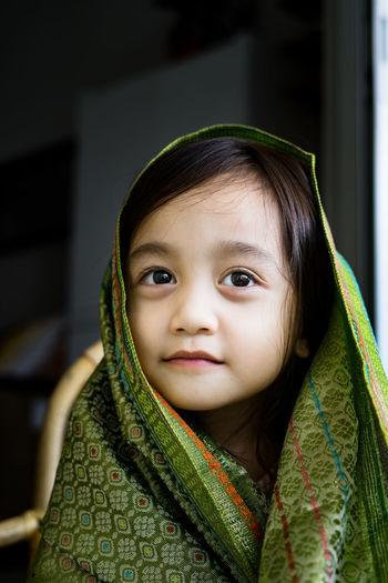 Portrait of cute girl looking away