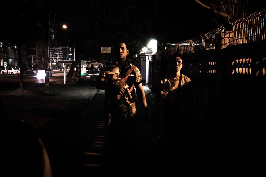 A family in the dark Creative Light And Shadow Street Photography Rangoon Myanmar