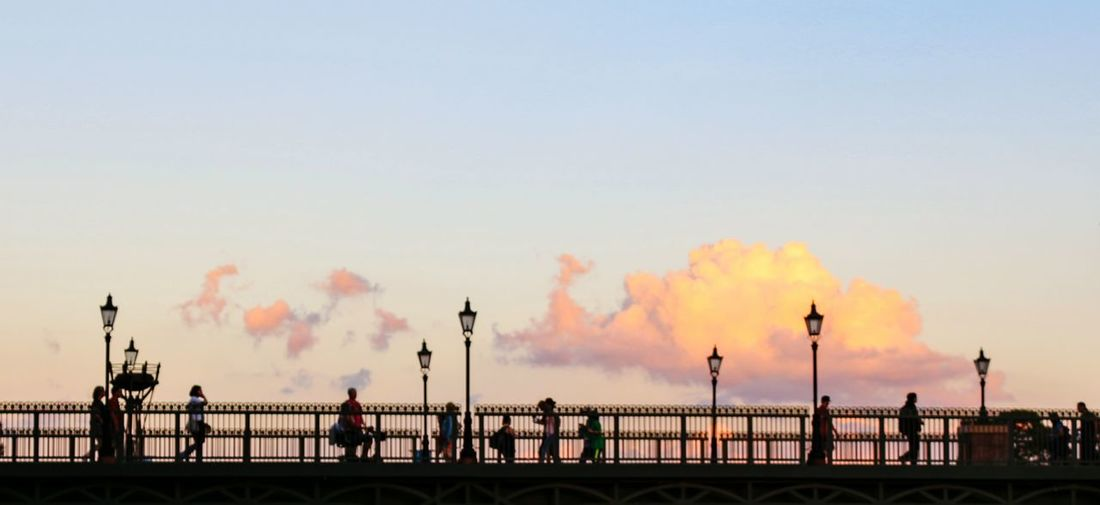 EyeEm Selects Railing Sky Architecture Epcot Disney World Clouds And Sky Cloudscape Bridge Over Water Dusk Sky Smoke - Physical Structure Sunset Silhouette Water Smoke Stack Day Outdoors Factory Adult People Adults Only Only Men EyeEmNewHere Postcode Postcards