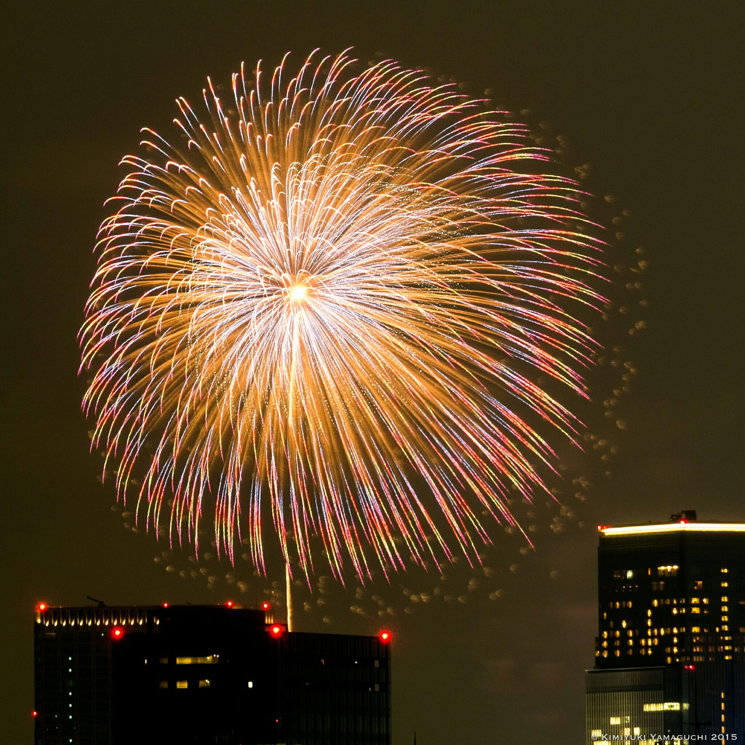 illuminated, night, firework display, celebration, exploding, firework - man made object, long exposure, arts culture and entertainment, low angle view, event, glowing, firework, sparks, building exterior, motion, entertainment, multi colored, built structure, sky, architecture