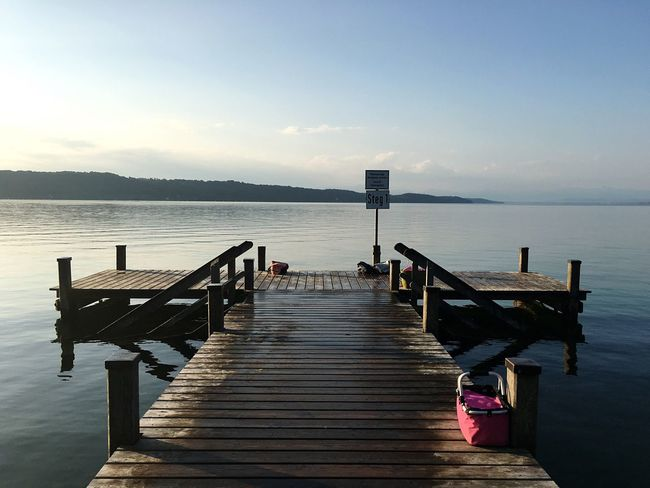 Water Pier Tranquil Scene Sea Tranquility Scenics Wood - Material Copy Space Clear Sky Nature Sky Jetty Wooden Post The Way Forward Beauty In Nature Calm Outdoors Day Dawn Ocean Inspiring Morning Pink Bag