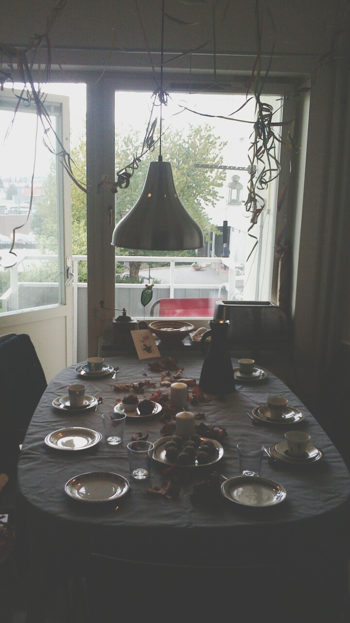 indoors, table, window, glass - material, food and drink, home interior, plate, transparent, restaurant, chair, drinking glass, absence, drink, dining table, day, refreshment, reflection, still life, food, glass
