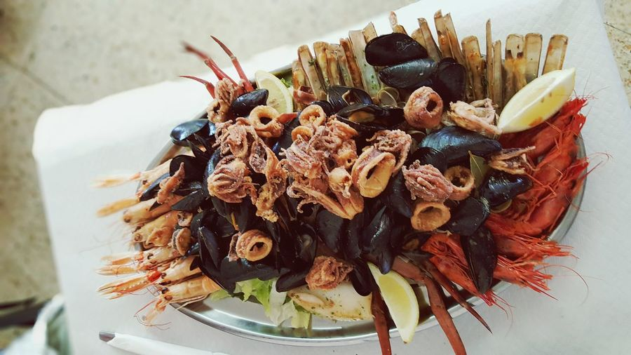 Top View Of Seafood Served On Plate