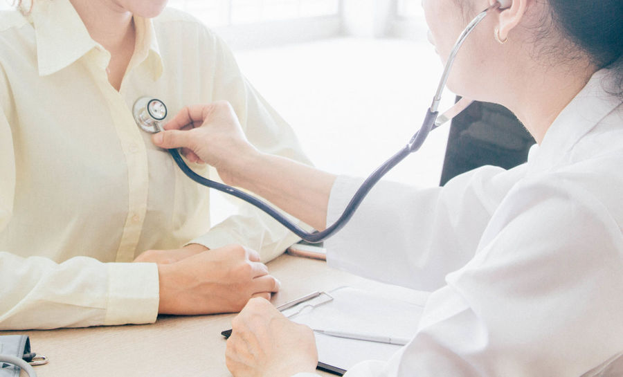 Doctor  Hospital Pain Sound Backgrounds Cardiologist Cardiology Clinic Doctor  Examining Fever] Healthcare And Medicine Hospital Indoors  Infection Listening Lung Medical Equipment Medical Exam Medical Occupation Patient Pulmonary Stethoscope  Two People Uniform