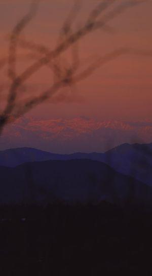 Beauty In Nature Cloud - Sky Dramatic Sky Environment Idyllic Landscape Majestic Mountain Mountain Peak Mountain Range Nature No People Non-urban Scene Orange Color Outdoors Romantic Sky Scenics - Nature Silhouette Sky Sunset Tranquil Scene Tranquility