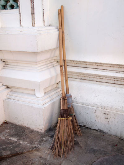 High angle view of broom against wall outdoors