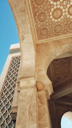 Hassan II Mosque Mosque Hassan Built Structure Architecture Low Angle View Arch Building Exterior History Column Architectural Feature Architectural Column Day Outdoors Historic Bridge Stone Material The Past Engineering Arched Sky Tall - High Arcade Casablanca, Morocco Morocco Casablanca
