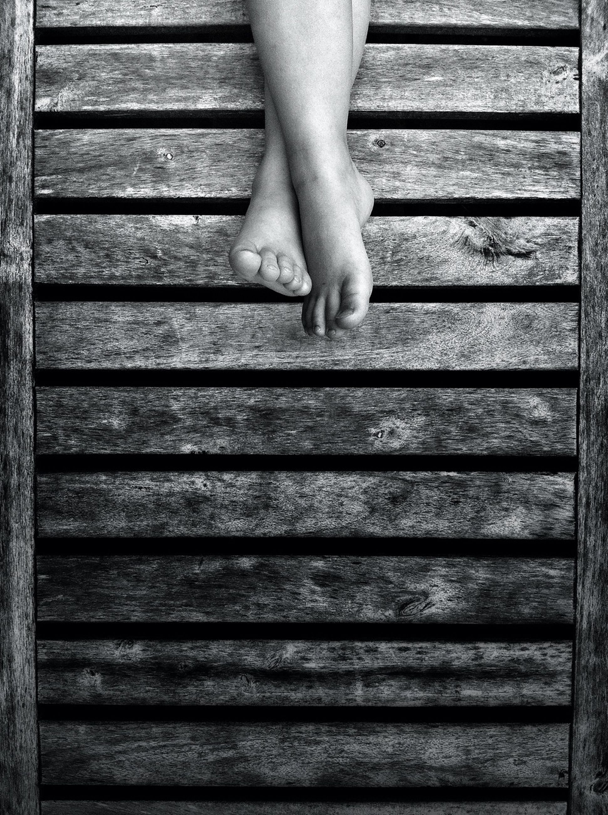 low section, person, part of, lifestyles, human foot, wood - material, standing, indoors, shoe, leisure activity, wooden, unrecognizable person, close-up, wood, steps