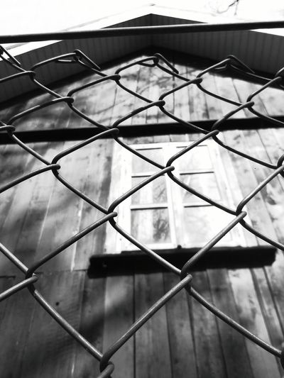Metal No People Day Outdoors Close-up Sky 3XSPUnity Lithuania EyeEmNewHere Black Background Black & White Architecture Sky And Clouds Creepy Window Old Buildings Wooden House Wood - Material Old Fence Metal Gate Madeup Of Squares Metal Gates Wire Gate Dark