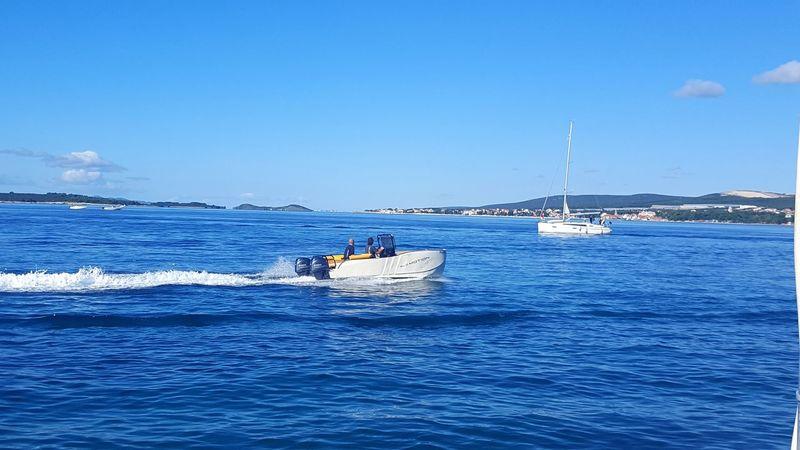 Blue Sea Water Nautical Vessel Transportation Outdoors Beauty In Nature Nature Sailing Sky Day Horizontal Sailboat Scenics Horizon Over Water Astrology Sign Cityscape Catamaran