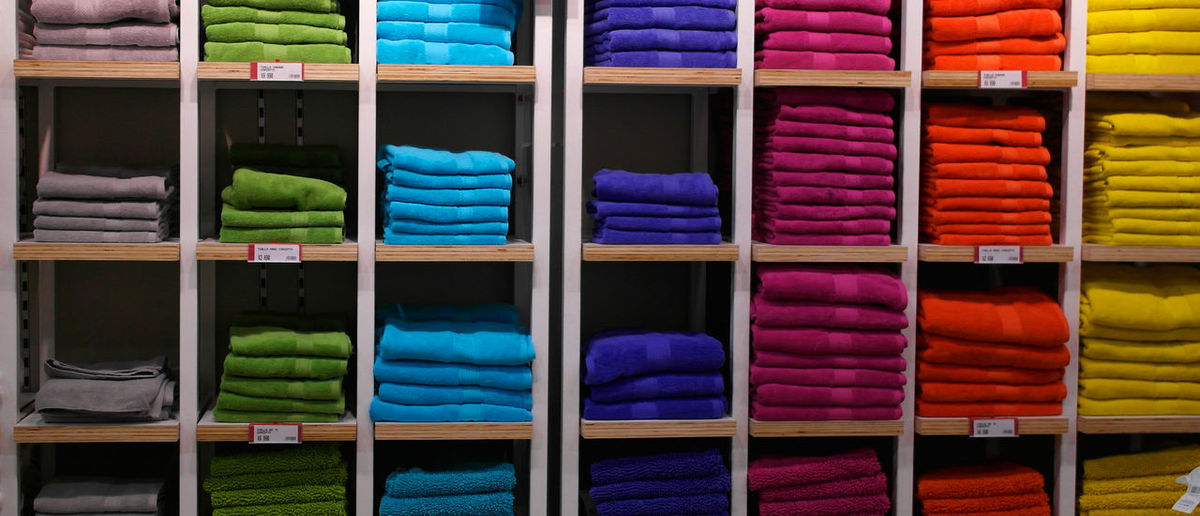 Full Frame Shot Of Colorful Clothes In Shelves At Shop For Sale
