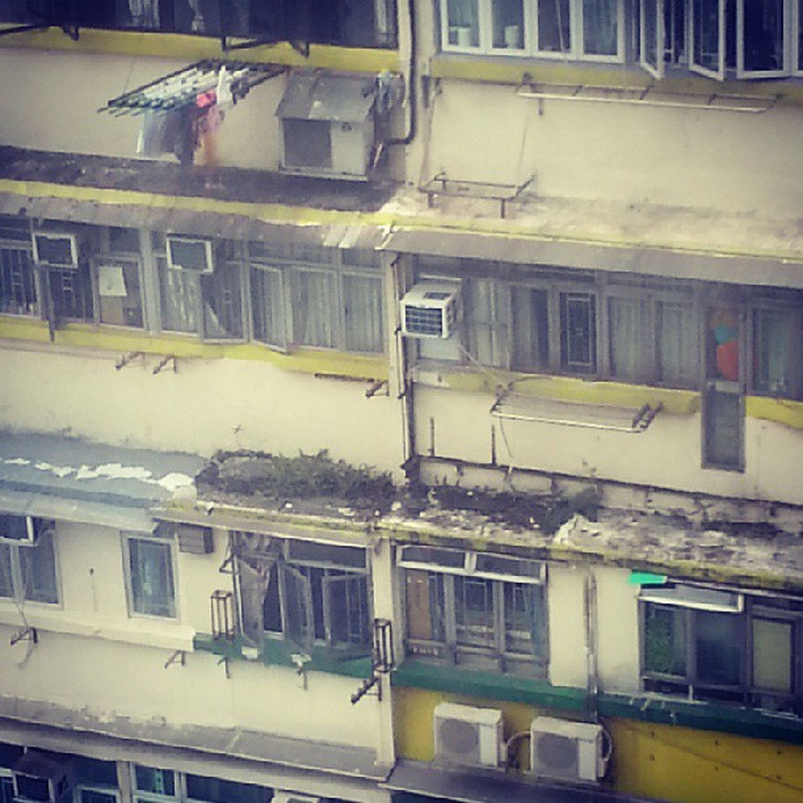 building exterior, architecture, built structure, window, residential building, residential structure, building, house, transportation, mode of transport, city, day, no people, outdoors, balcony, old, abandoned, exterior, sunlight, apartment
