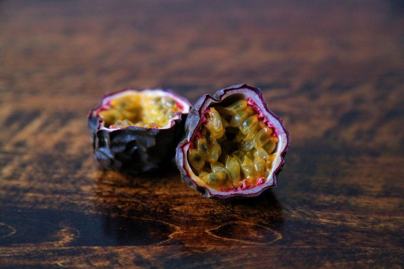 Close-up of halved passion fruit on table