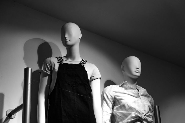 Low angle view of female sculpture at store
