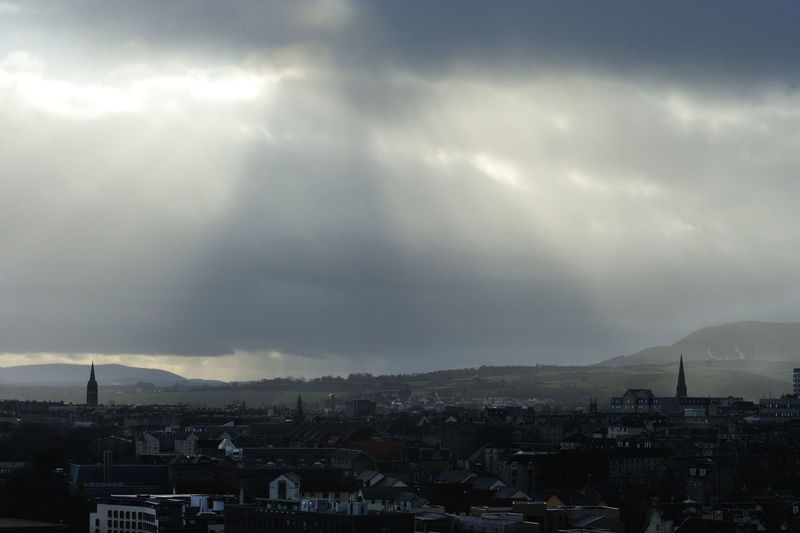 Between Two Spires: the view over Edinburgh from Calton Hill as rain heads in Edinburgh Scotland Sky Storm Overcast TOWNSCAPE Storm Cloud Mountain No People Outdoors Cityscape Town City Architecture Spires Light Shafts Light And Dark