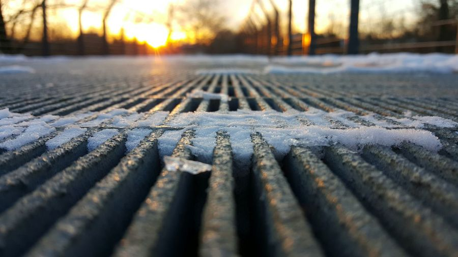 Focus On Foreground Outdoors Cold Temperature Sunset No People Close-up Nature Day Winter Steel Bridge Low Angle View Texture Winter Sunset Evening Light Park Bare Trees Urban Nature Converging Lines Steel Snow Light Snow