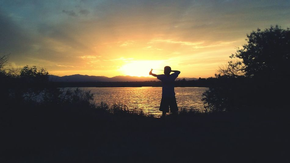 David And Goliath Slingshot Water Tree Sunset Standing Full Length Lake Silhouette Reflection Sky Cloud - Sky Shining Horizon Over Water Calm EyeEmNewHere