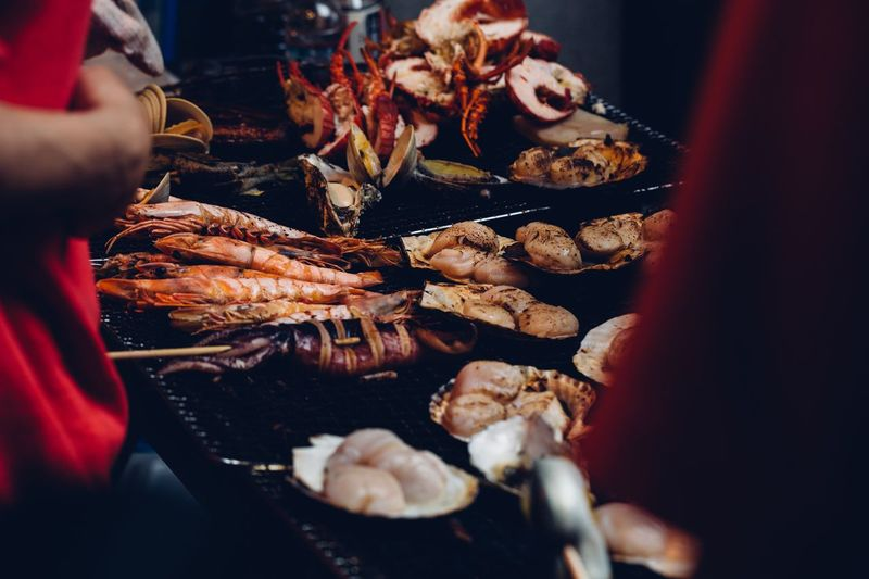 Seafood on grill Tokyo Tokyo,Japan Foodphotography Japanese Food Tsukiji Tsukiji Fish Market Barbecue Fish Market Street Food Street Food EyeEm Selects Food And Drink Food Freshness Selective Focus One Person Indoors  Market Celebration Market Stall