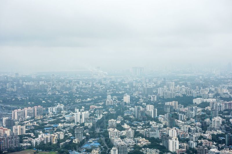 Mumbai on a cold morning flight City Architecture Cityscape Building Exterior Built Structure Building It's About The Journey Sky Aerial View Landscape Residential District Office Building Exterior Skyscraper High Angle View Fog Environment Outdoors Modern