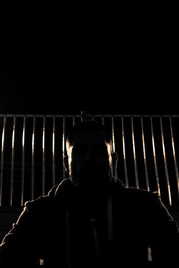 Portrait of man in dark room