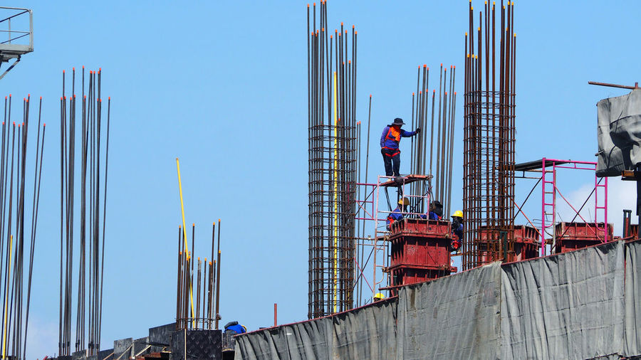 Low angle view of construction site against clear sky