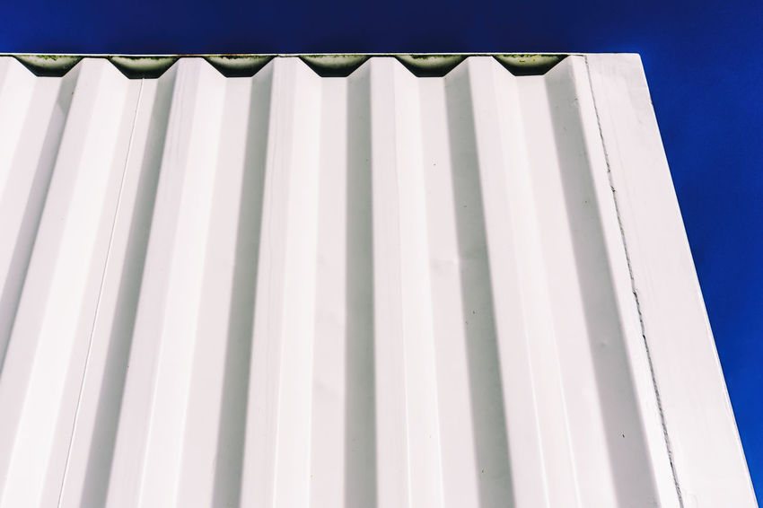 Close-up of white shipping container Architecture Berlin Built Structure Close-up Day Dented Germany 🇩🇪 Deutschland Horizontal Low Angle View No People Outdoors Parallel Shipping Container Sky White