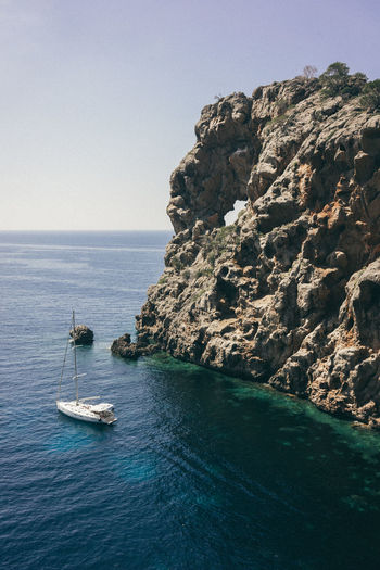 Cala De Sa Costa Brava Es Cuco Mallorca Beauty In Nature Blue Clear Sky Cliff Coast Day Horizon Over Water Mode Of Transport Mountain Nature Nautical Vessel No People Outdoors Rock - Object Sailing Scenics Sea Sky Spaın Tranquil Scene Tranquility Transportation Water Waterfront