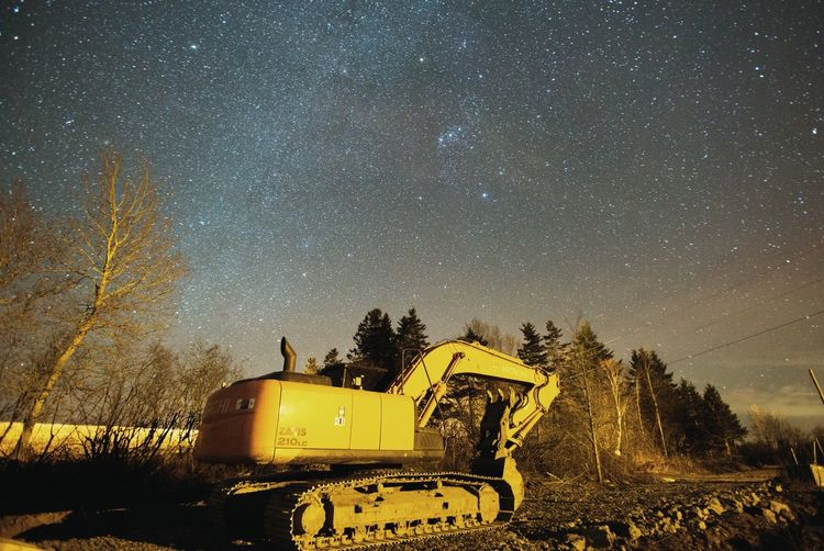 Earth Mover On Field Against Sky At Night