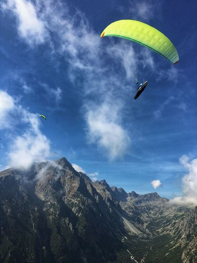Aerial view of people paragliding against sky