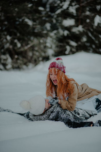 Portrait of woman covered with snow during winter